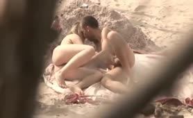 Couple fun and blow job in the beach